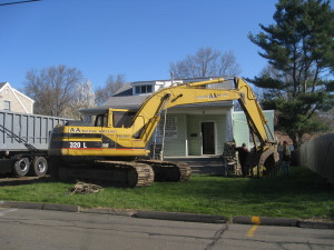 Wrecking equipment tears into Gustave Whitehead's historic home, morning of April 28th.